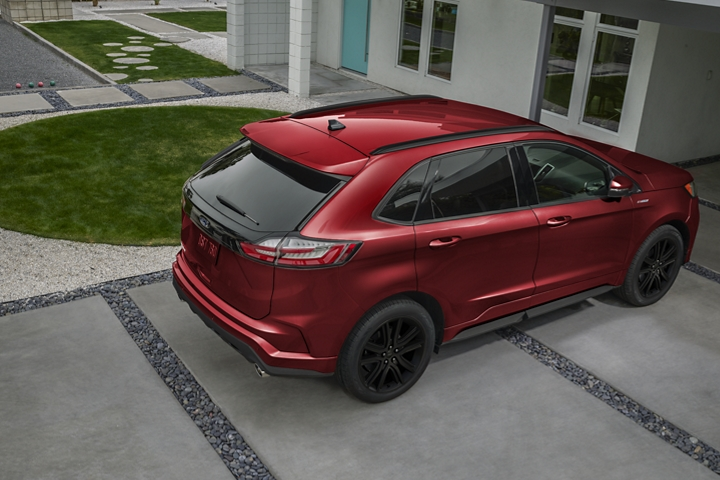 2020 Ford Edge S T Line in Rapid Red shown from above parked in driveway of large home