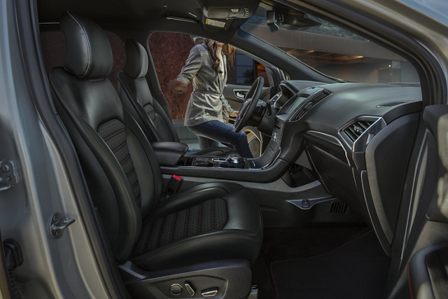 Side view of 2020 Ford Edge S T Line Interior with woman opening drivers side door