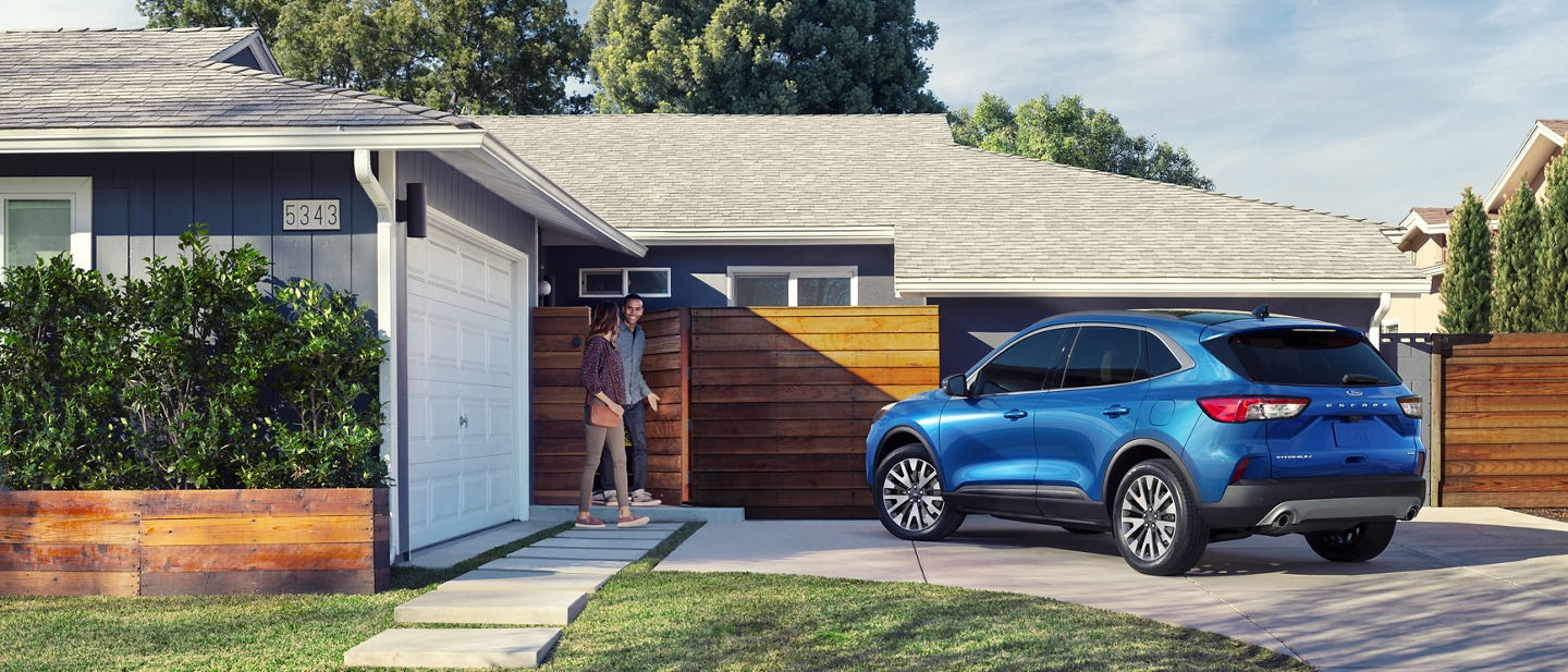 2020 Ford Escape Titanium in Velocity Blue parked in residential driveway