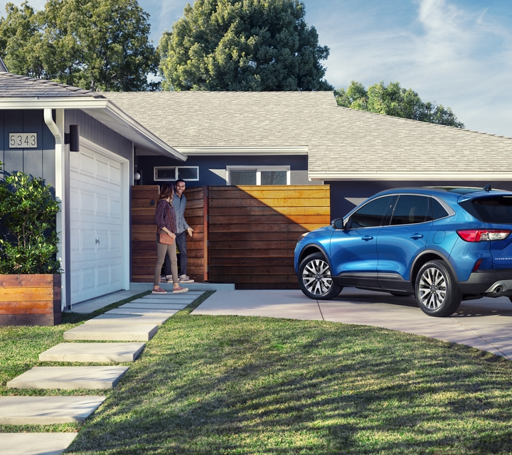 2020 Ford Escape in Velocity Blue parked in a residential driveway