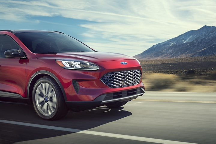 2020 Ford Escape S E Sport Hybrid Premium Package in Rapid Red looking good on the open road