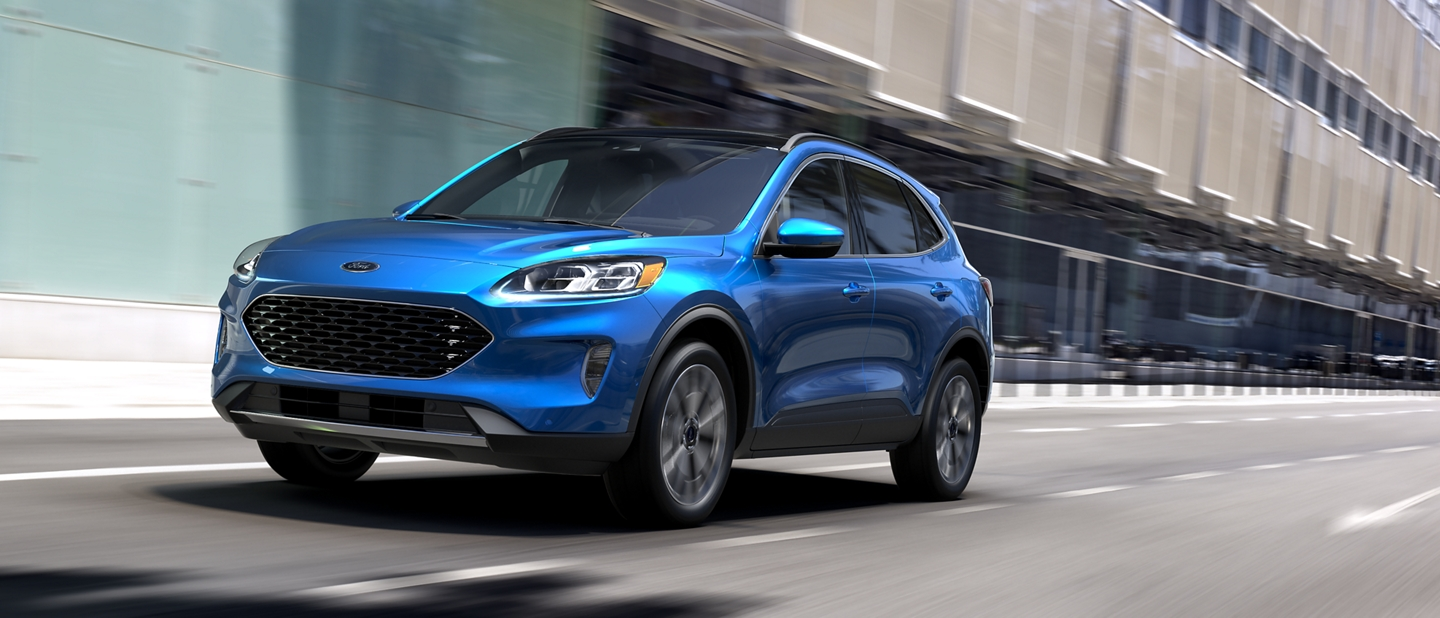 2020 Ford Escape in Velocity Blue being driven on city street