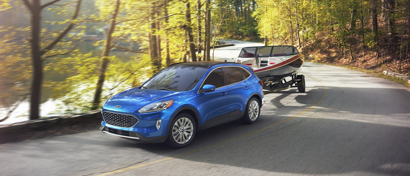 2020 Ford Escape in Velocity Blue towing a boat