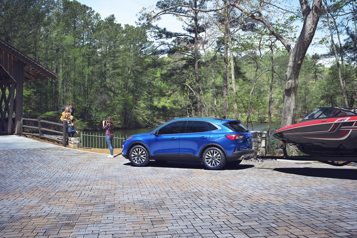 2020 Ford Escape Titanium with available Class 2 Trailer Tow Package parked by a river bridge