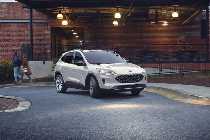 2020 Ford Escape S E Sport Hybrid in Star White Metallic Tri coat out in the twilight