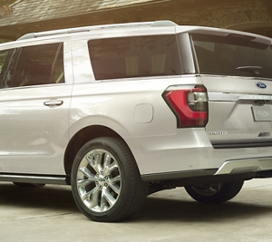 Ford Expedition Shown In White Platinum Metallic Tri Coat In The Driveway
