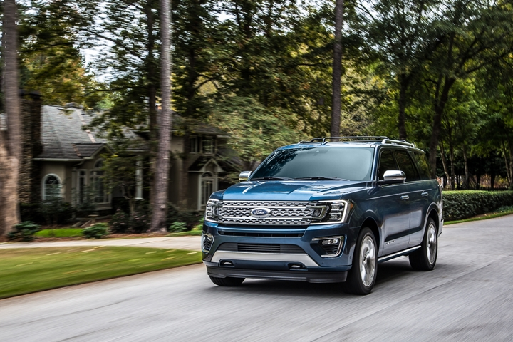 2020 Ford Expedition Platinum in Blue being driven through a neighborhood