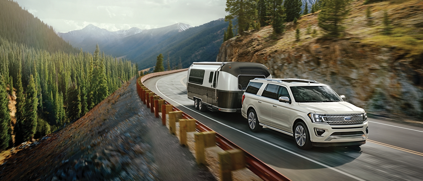 2020 Ford Expedition on the open road towing a trailer
