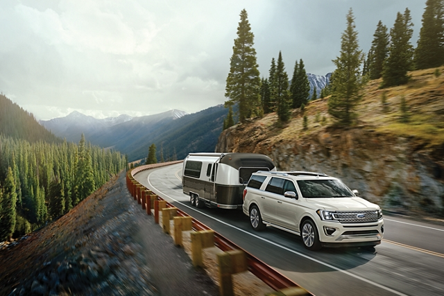 2020 Ford Expedition with available Panoramic vista roof towing a trailer