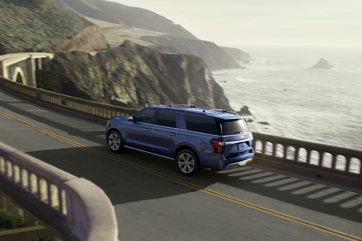 Blue 2020 Ford Expedition Platinum MAX being driven by ocean