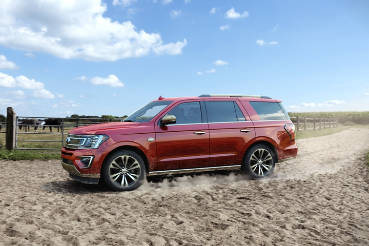 2020 Ford Expedition King Ranch on a ranch shown in Burgundy Velvet with 22 inch wheels unique center cap