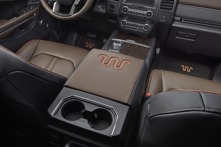 Distinctive 2020 Ford Expedition King Ranch center console with Ziricote wood veneer with covered and uncovered beverage holders
