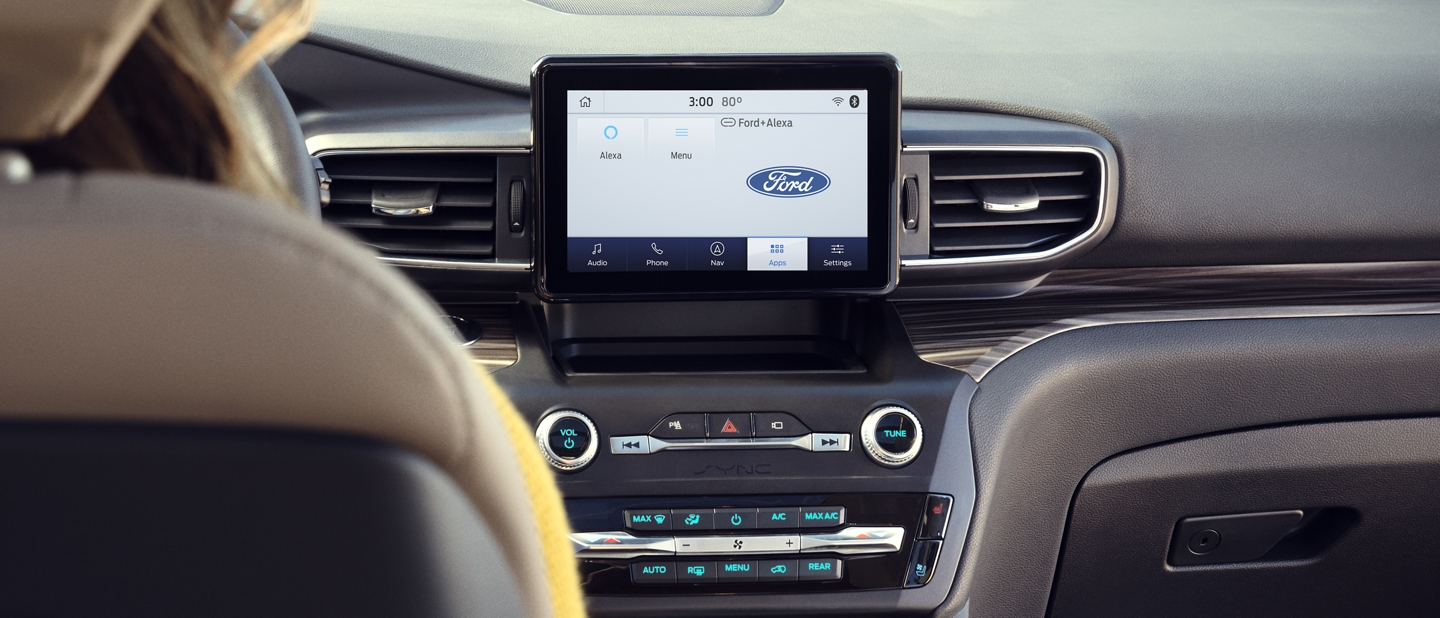 A close up view of an Explorer dashboard featuring a portrait touchscreen in the center stack and SYNC 3