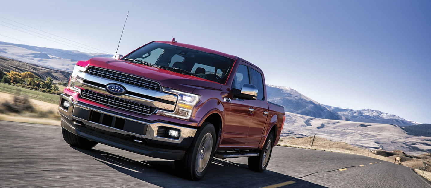 2020 Ford F 1 50 lariat driving on the highway with mountains in the background