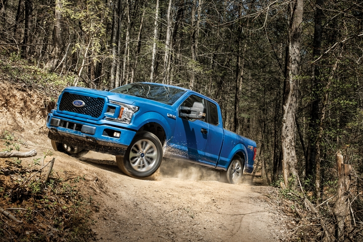 2020 Ford F 1 50 S T X with F X 4 Off Road Package uphill on dirt road
