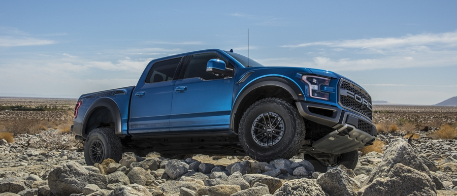 2020 Ford F 1 50 Raptor crawling over heavy rocks