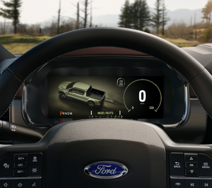 A close up of the 2021 Ford F one fifty steering wheel and dash