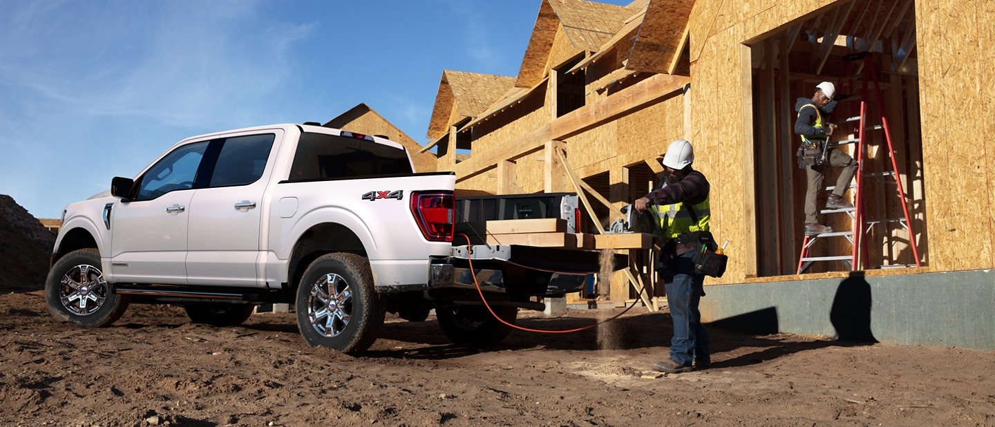 A construction worker using the pro power on board from a 2021 Ford f one fifty
