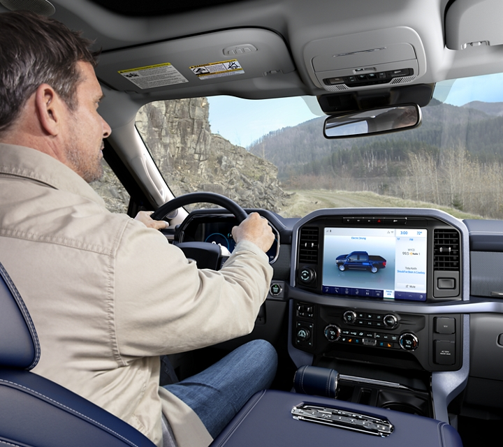 A man behind the wheel of a 2021 Ford f one fifty