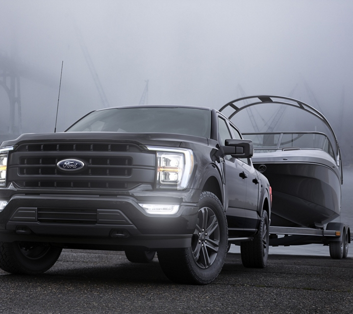 A 2021 Ford F one fifty parked at a dock at dusk