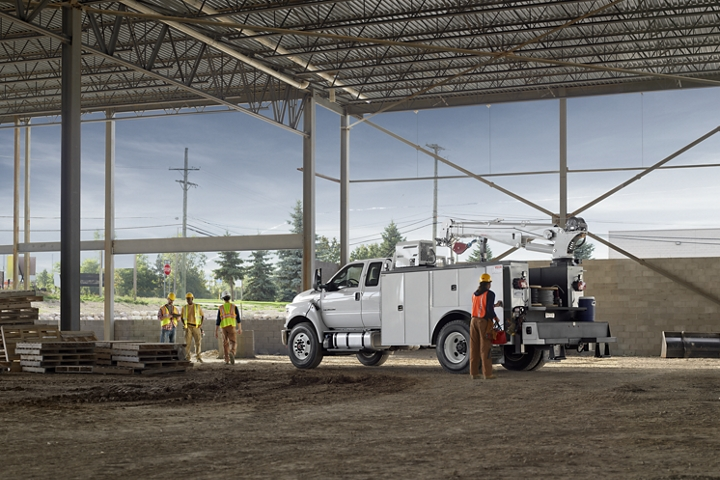 Workers near 2021 Ford F 7 50 SuperCab with mechanic truck upfit in Oxford White parked at construction site
