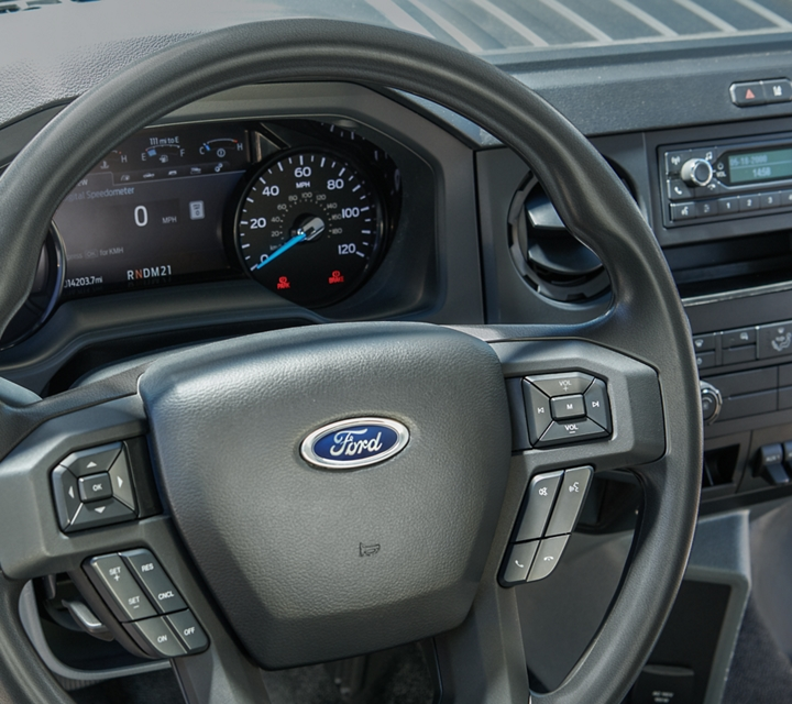 Close up on 2021 Ford F 7 50 Instrument Panel Cluster and Tilt Telescoping Steering Wheel with Integrated Audio Controls