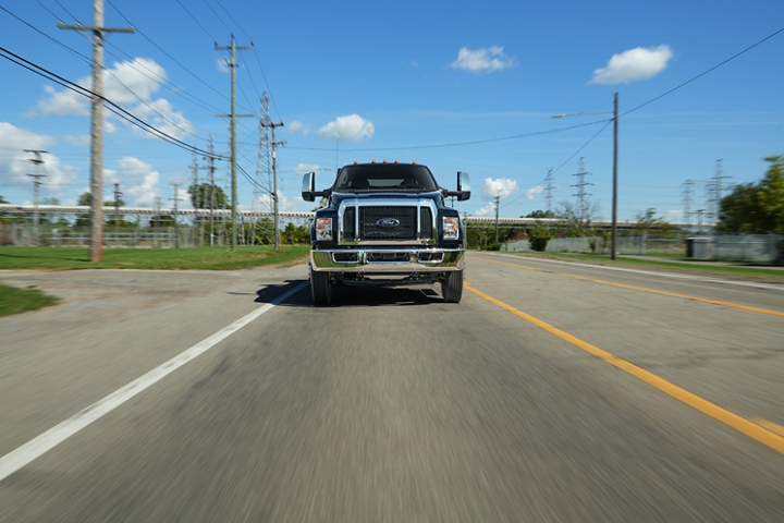 2021 Ford F 7 50 Crew Cab in Shadow Black being driven on road near telephone lines