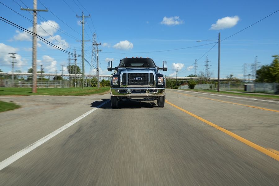 2020 Ford F 7 50 Crew Cab in Shadow Black being driven on road near phone lines
