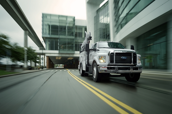 2021 Ford F 7 50 SuperCab with mechanic truck upfit in Oxford White being driven near large buildings
