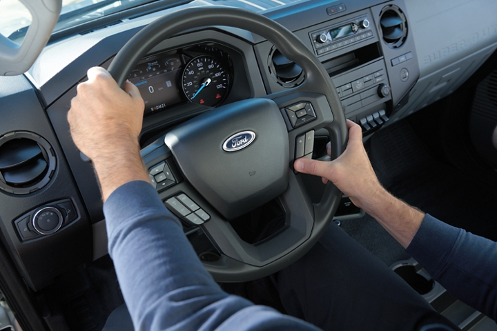 Hands using wheel mounted controls on 2021 Ford F 7 50 Steering Wheel