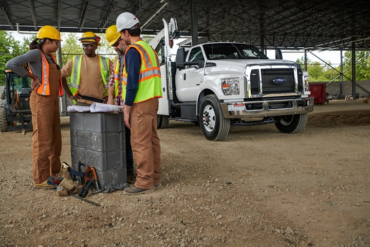 Workers gathered alongside 2021 Ford F 7 50 SuperCab with mechanic truck upfit in Oxford White in background