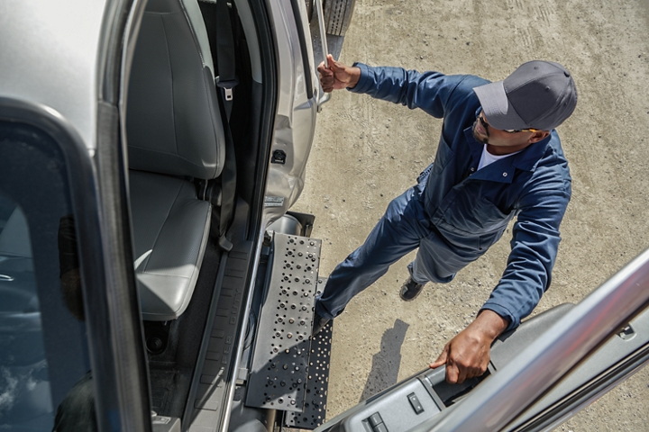 Driver entering 2021 Ford F 7 50 Regular Cab in Iconic Silver