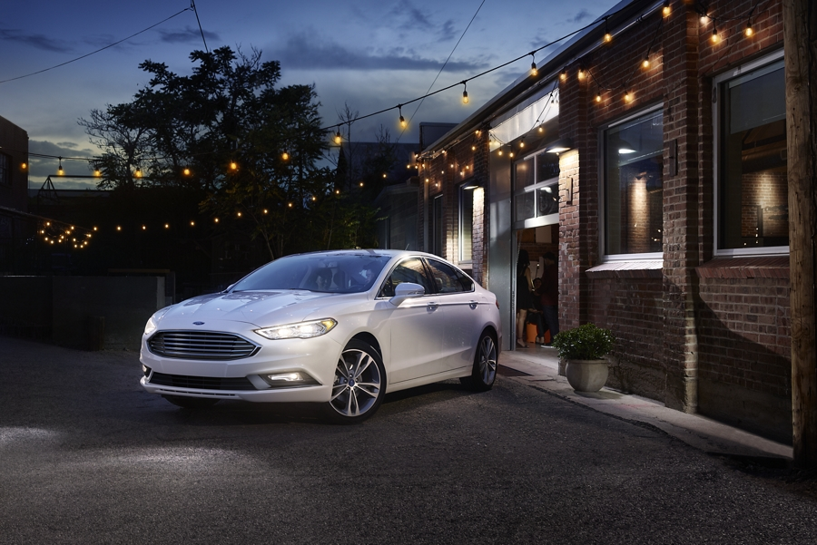 2020 Ford Fusion Titanium shown in White Platinum Metallic tri coat parked in front of a home at night