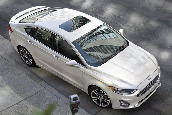 2020 Ford Fusion Titanium with standard moonroof parked next to a parking meter