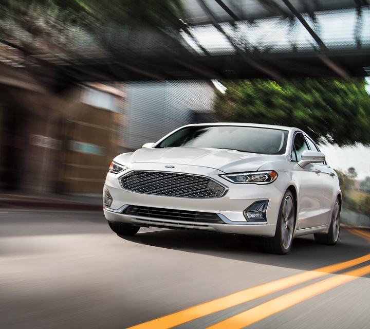 A 2020 Ford Fusion being driven on an open street