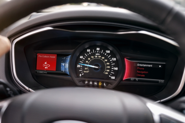 The instrument cluster in the 2020 Ford Fusion showing a pre collision brake assist icon
