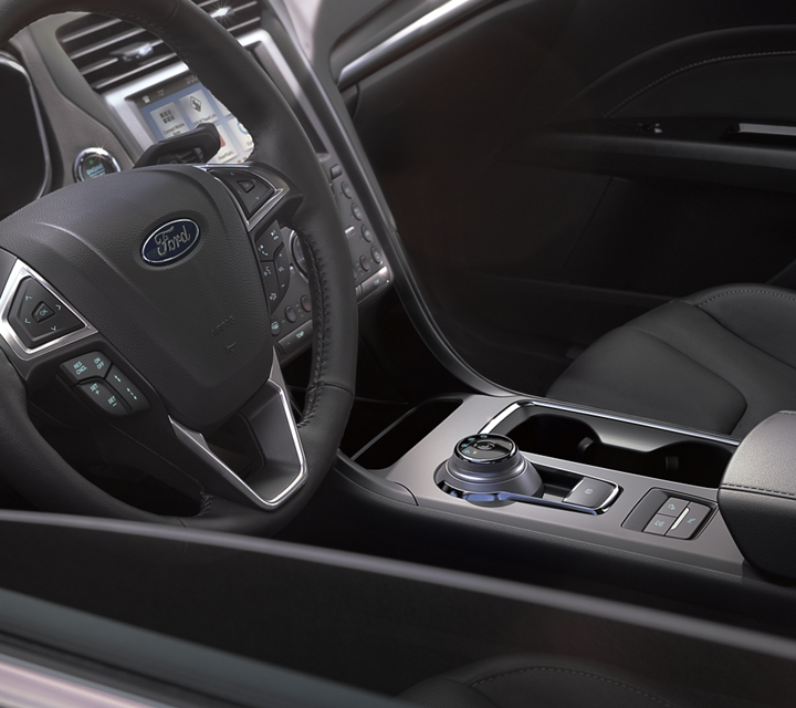2020 Ford Fusion Plug in Hybrid Titanium interior shown with premium leather trimmed seats in Ebony