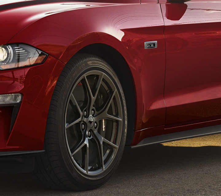 2020 Ford Mustang Ecoboost in race red parked on a city street