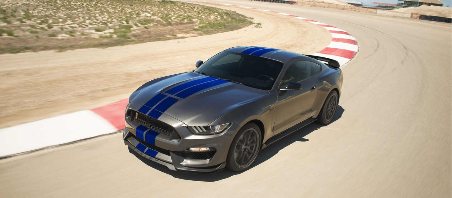 2020 Ford Mustang on a track being driven around a curve