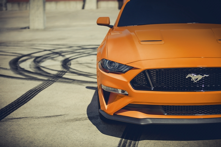 2020 Ford Mustang in Twister Orange Metallic tinted clearcoat parked with skid marks in the background