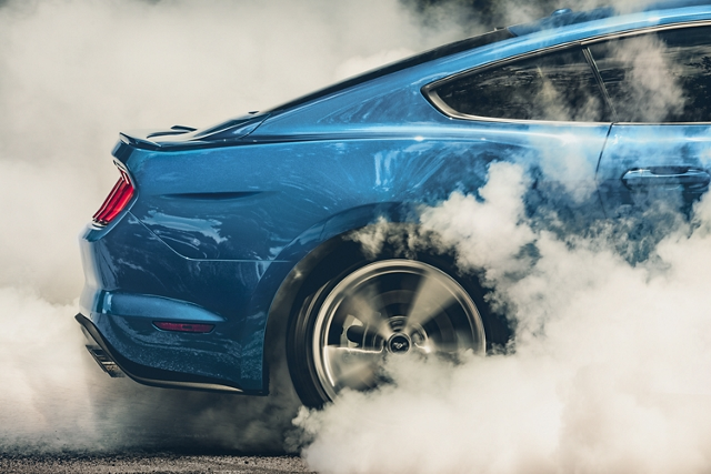 A 2020 Ford Mustang doing a burnout