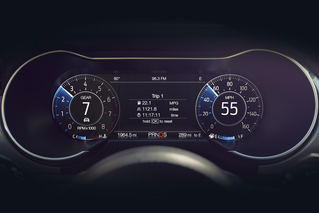 A closeup of the customizable instrument cluster with my color and my mode