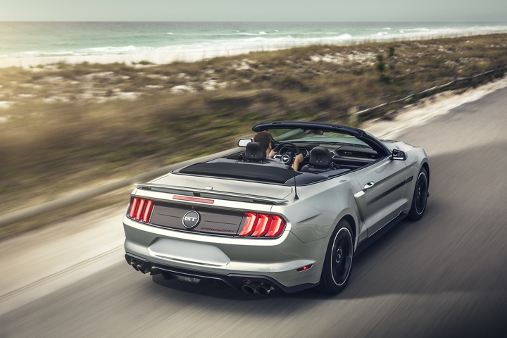 2020 Ford Mustang convertible traveling down a highway near beach