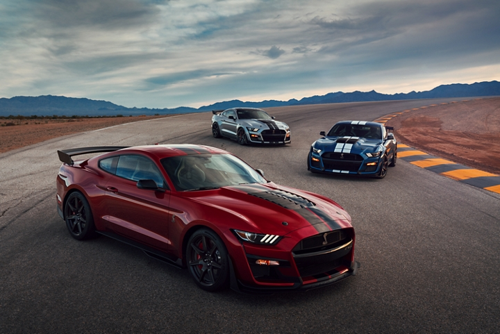 Three 2020 Ford Mustang G T 500s staggered on a road in the desert