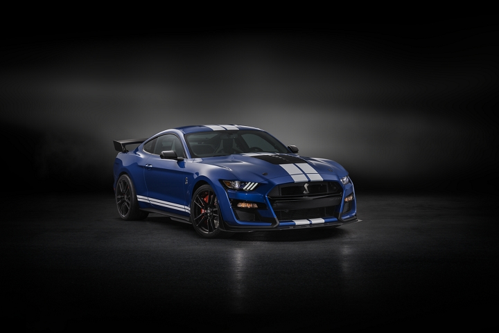 A 2020 Ford Mustang G T 500 in Kona Blue in a dark room