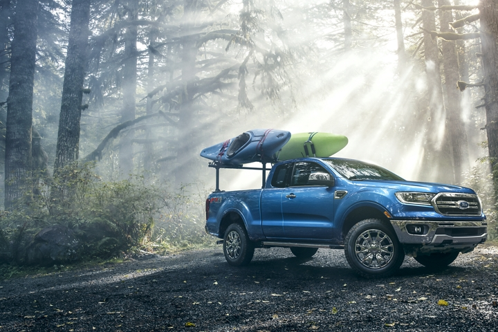 2019 Ford Ranger on forest road with kayaks on optional bed mounted rack accessory