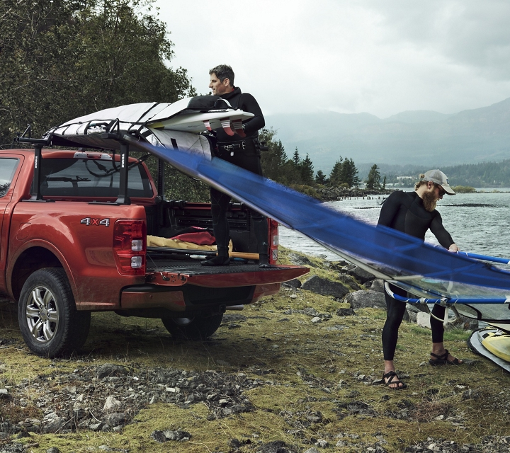2019 Ford Ranger at mountain lake shown with optional bed mounted rack accessory