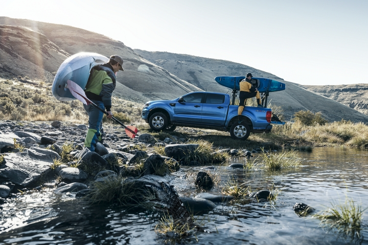 2019 Ford Ranger with kayakers at stream with optional bed mounted rack accessory