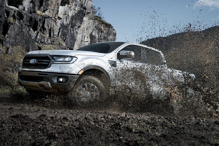 2019 Ford Ranger traveling uphill through water and mud