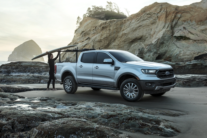 2019 Ford Ranger at oceanfront with surfer shown with optional bed mounted rack accessory